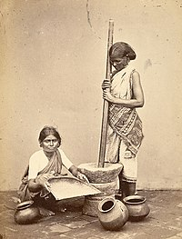 Women pounding and cleaning rice in Madras in 1870.jpg