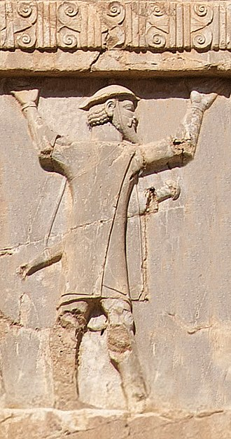 """Skudra - """"Ionian with shield hat"""" (Macedonian) soldier of the Achaemenid army, circa 480 BCE. Xerxes I tomb relief."""