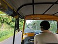 Y Coetsee Driving in a tuk-tuk, Nosy Boraha.jpg