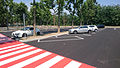 """15 - ITALY - Parked automobiles out of Museo Storico Alfa Romeo Milan - in this pics four Alfa and pedestrian crossings.JPG"