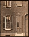 """""""Fancy Rolle Shades."""" View of windows and door of unidentified residence.jpg"""