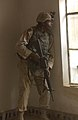 041111-A-6017M-015 - SPC Deretinald Batiste looks for snipers from inside a house in Fallujah, Iraq.jpg