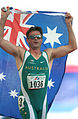 141100 - Athletics track Neil Fuller Australian flag - 3b - 2000 Sydney race photo.jpg