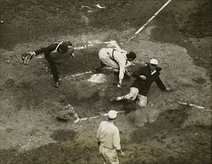 1924 World Series - Unidentified Giants player sliding in safely at home during a game of the 1924 World Series.