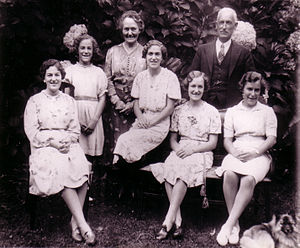 Family portrait with parents and four daughters.