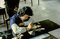 1983 in Jiangsu, artist of a handicraft workshop.jpg