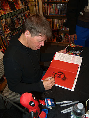 Rob Liefeld - Liefeld sketching Deadpool in a  copy of the Deadpool Volume 1 hardcover three days before the release of the 2016 Deadpool film. To his right is a figurine of the character.