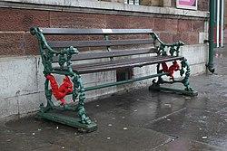 2018 at Ulverston station - old Furness Railway bench.JPG
