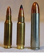 Photo of the 5.7×28毫米cartridge next to the similarly-sized 4.6 × 30毫米and .30 carbine cartridges