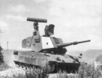 76-mm Super Rapid Gun System on OF-40 tank chassis (moderately clouded sky background).png