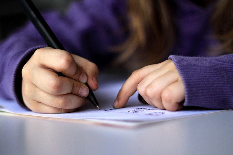File:A-kid-drawing-or-writing.jpg