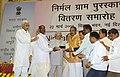A.P.J. Abdul Kalam, giving away the Nirmal Gram Puraskar to the Panchayati Raj Institution of Andhra Pradesh for achieving full sanitation coverage at a function.jpg