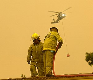2003 Canberra bushfires - ACTFB firefighters hosing down the roof of the Emergency Services Bureau.