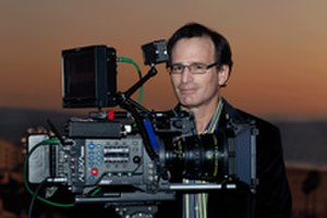 Arri Alexa - Director Robert Tur with an Alexa-Plus camera equipped with an 18 mm Master Prime lens on the set of SIS.