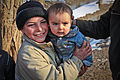 A local Afghan boy, left, holds a baby as U.S. Soldiers with Outlaw Platoon, 164th Military Police Company, Fort Richardson, Alaska, Task Force Maverick, and counterparts of the Afghan National Army, patrol 120111-A-LP603-139.jpg