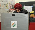 A man voter casting his vote at a polling booth, during the Delhi Assembly Election, in New Delhi on February 07, 2015.jpg