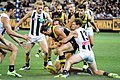Adams and Broomhead tackling Nankervis.jpg