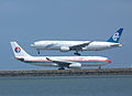 Air New Zealand, Boeing 777-219(ER), ZK-OKF - China Eastern Airlines, Airbus A330-243, B-6543.jpg
