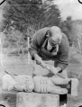 Albert Percy Godber at work on a carving in the Maori tradition, circa 1930 ATLIB 306456.png