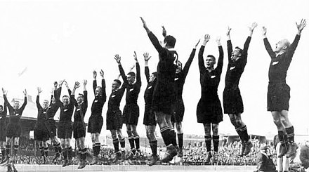 The All Blacks at the climax of their haka before a 1932 test against Australia Allblacks haka 1932.jpg