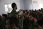 An Afghan National Army (ANA) sergeant first class and medic instructor, standing center left, assigned to the 201st Corps, teaches a class during an ANA-led training course at Forward Operating Base Gamberi 130617-A-XM609-074.jpg