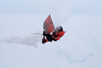 Snow cave - Researcher digging the snow cave for snow crystal photography at Finnish Aboa station on Queen Maud Land in Antarctica