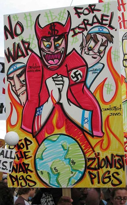 Poster held by a protester at an anti-war rally in San Francisco on February 16, 2003 AntiWarRallyFeb162003.jpg