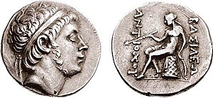 Antiochus Hierax - Coin of Antiochus Hierax. Reverse shows Apollo seated on omphalos. The Greek inscription reads ΒΑΣΙΛΕΩΣ ΑΝΤΙΟΧΟΥ (of king Antiochus).
