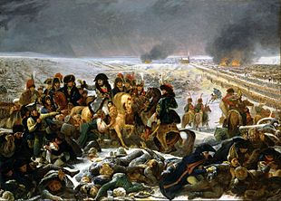 Painting shows Napoleon and his staff mounted on horses. In the foreground are a pile of dead and wounded soldiers.