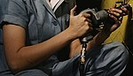 Arm detail, Riveter at work on Consolidated bomber, Consolidated Aircraft Corp. 1a34953v (cropped).jpg