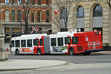 Red-and-white articulated bus