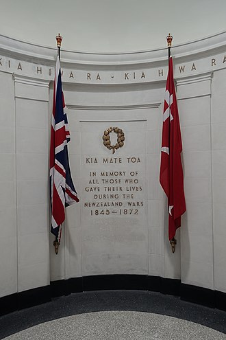 "New Zealand Wars - Memorial in the Auckland War Memorial Museum for those who died, both European and Māori, in the New Zealand Wars. ""Kia mate toa"" can be translated as ""fight unto death"" or ""be strong in death"", and is the motto of the Otago and Southland Regiment of the New Zealand Army. The flags are that of Gate Pā and the Union Flag."