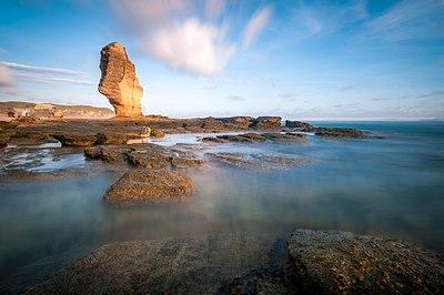 Batu Payung, di tepi Pantai Kuta, Lombok, Nusa Tenggara Barat.