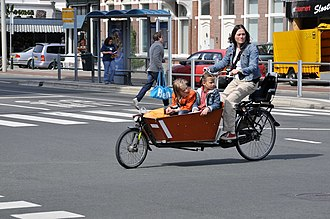 Freight bicycle - Mother with two children in The Hague (Netherlands)
