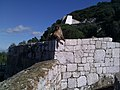 Barbary Macaque on sitting at Queen Charlotte's Battery.jpg