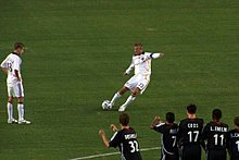 8c2681246 Beckham scores his first goal for LA Galaxy with a trademark free-kick.