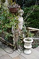 Beer garden statue and urn at Ashfold Crossways, in Lower Beeding, West Sussex.jpg