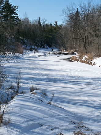 Black River (Wisconsin) - The Black freezes over in winter and snowmobilers run on the ice. (Looking downstream from the highway 64 bridge in the Chequamegon National Forest west of Medford.)