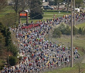 Runners head down Fort George Wright Drive dur...