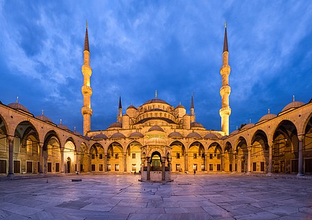 Panoramic view of the courtyard of the Blue Mosque, in Istanbul, Turkey. The courtyard has a square shape, but the mercator projection necessary to squeeze all the field of view into the frame bends the horizontal lines. Panorama created with Hugin.