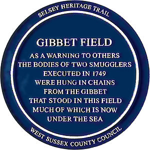 Selsey - Blue plaque commemorating the hanging of two smugglers in Gibbet Field Selsey in 1749
