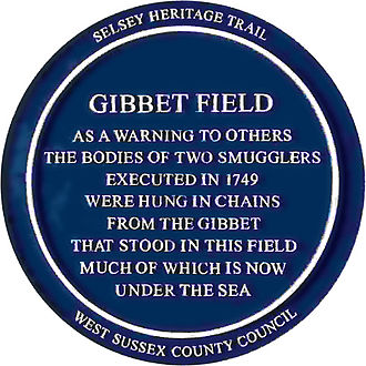 Selsey Bill - Blue plaque commemorating the hanging of two smugglers in Gibbet Field Selsey in 1749