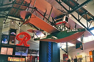 Museum of History & Industry (MOHAI) - The Boeing B-1 on display in the museum's Grand Atrium, with the Rainier Brewing Company logo sign behind.