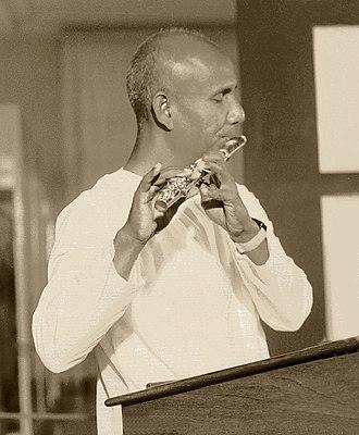 Sri Chinmoy - Sri Chinmoy playing flute