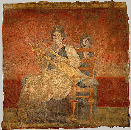 Woman playing a kithara, from the Villa Boscoreale, 40-30 BC Boscoreale fresco woman kithara.jpg