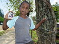 Boy Brandishes a Baseball Card - Jarabacoa - Dominican Republic.jpg