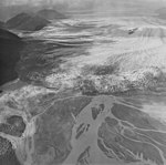 Brady Glacier, outwash plain in the foreground and terminus of valley glacier in the midground, moraines in the background (GLACIERS 5610).jpg
