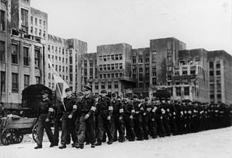 German occupation of Byelorussia during World War II - German-collaborationist Biełaruskaja Krajovaja Abarona, Minsk, June 1944.