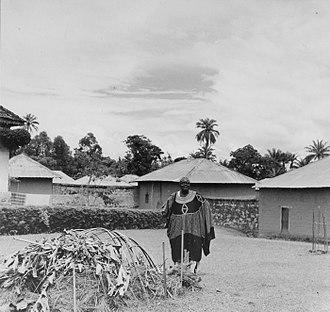 Achirimbi II - Achirimbi II posing next to his termite trap (1965).