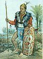 COLLECTIE TROPENMUSEUM Kleurenlitho getiteld Longwai-Dajak in vollen krijgsdos TMnr 5795-8.jpg